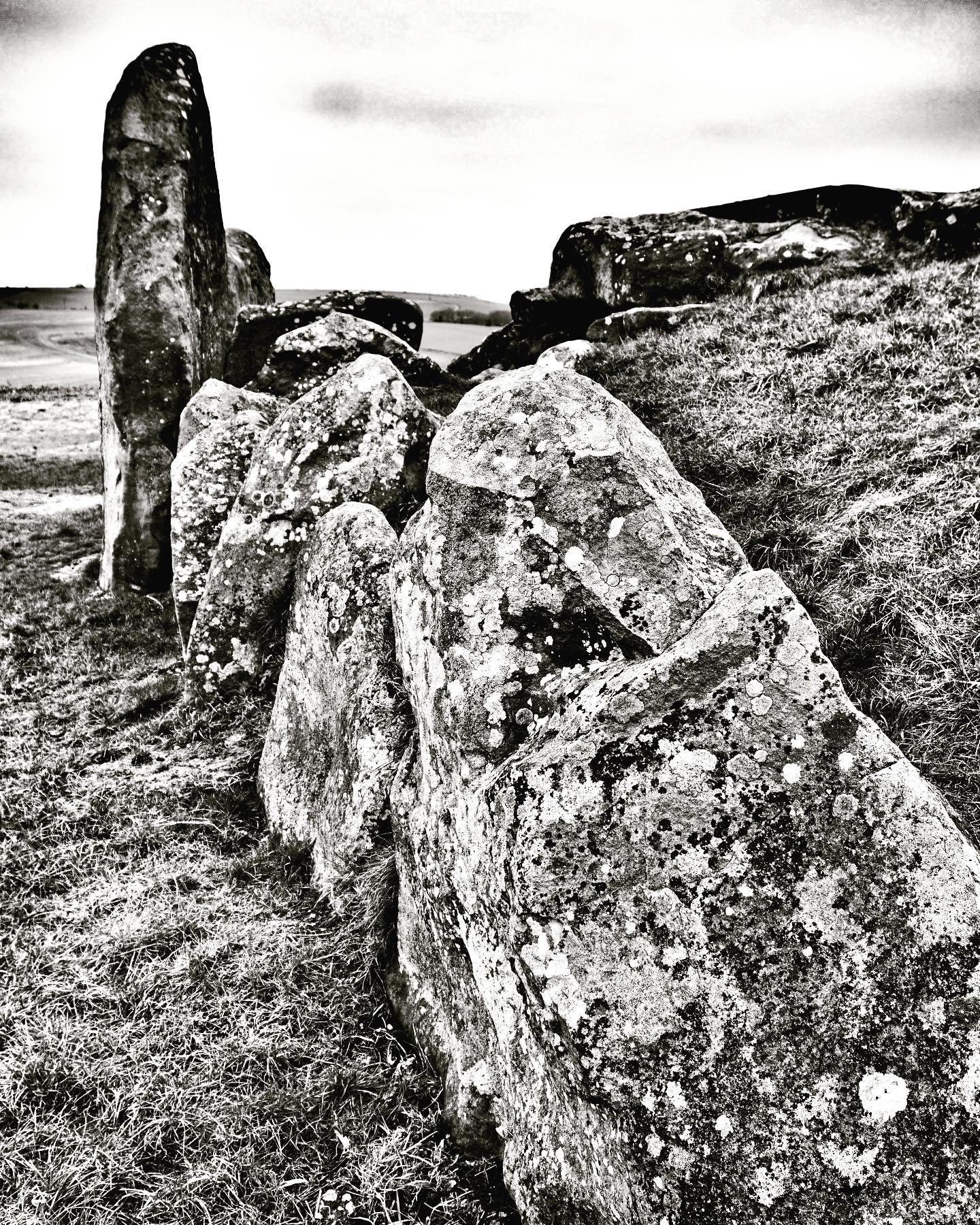 west kennet long barrow. after the first burials in around 36725-70 bce it was again reused between 3620 and 3240 BCE as a burial space, receiving both human and animal remains over a period of several centuries. various flint tools and ceramic sherds were also placed within it. during this period in the late neolithic, the entrance to the long barrow was blocked up with the addition of large sarsen boulders. this period of the later neolithic and early bronze age, the landscape around west kennet long barrow was subject to the widespread construction of ceremonial monuments... #earlyneolithic #neolithic #archaeology #longbarrows #westkennet #cotswoldsevern #costwoldseverngroup #avebury #earlyagriculture #ceremonia #blockingstonemore at montagecity.com