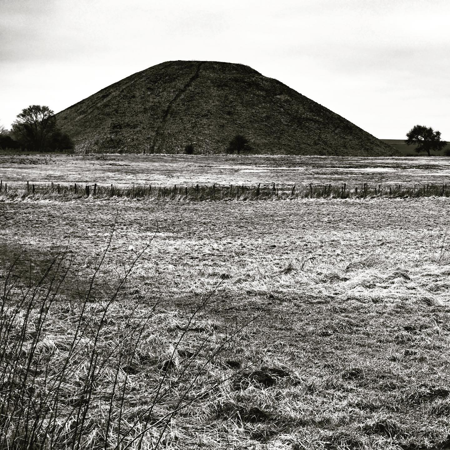 silbury hill avebury. during the late neolithic and early bronze age, the landscape around west kennet long barrow was subject to the widespread construction of ceremonial monuments, among them the avebury henge and stone circles, the west kennet avenue, the sanctuary, and silbury hill. the largest artificial hill monument in europe. #silburyhill #avebury #westkennet #artificialhill