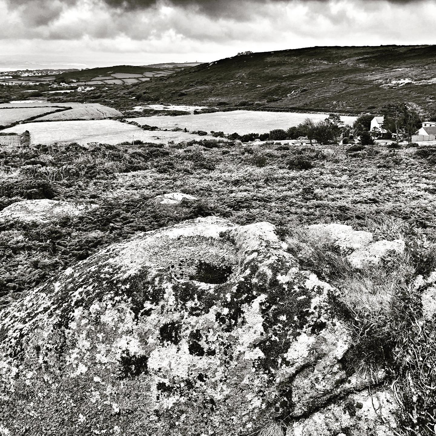 solutions basin travalgen hill. large bolder with basin some 80cm in diameter. the silhouette of rosewall hills's stone tors in the background. #water #ceremony #ceremonial #sacred #solutionsbasin #basin #archaeology  #stonefeature #ancestors #ancientknowledge #travalgen #rosewallhill
