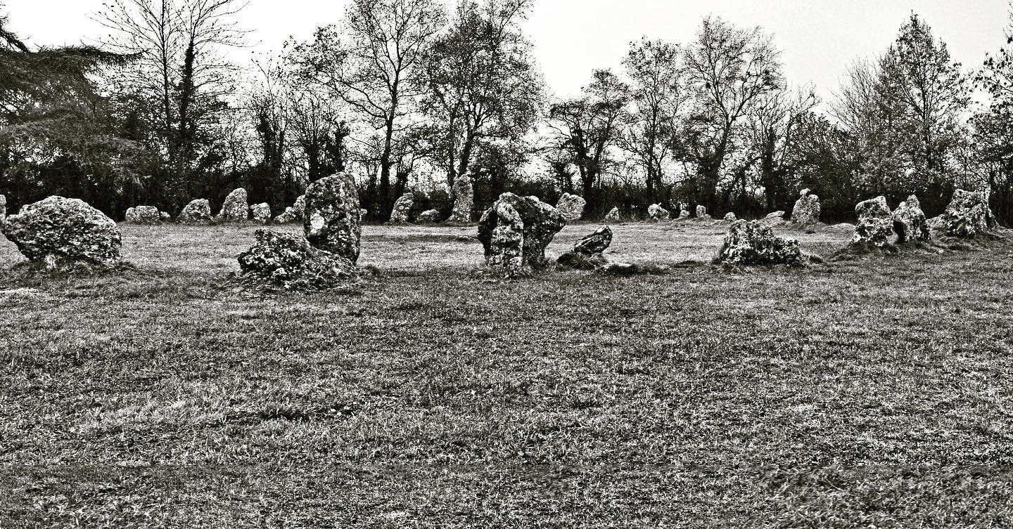 rollright stone circle. 'the kings men' on the the borders of oxfordshire and warwickshire near chipping norton. it has been dated to the kate neolithic. it has been calculated that given that the oolotic limestone monoliths are heavily weathered surface stones and probably sledged to the site from position lower in the valley, it would have taken twenty people some four weeks to construct the circle but would have required careful planning and some geometrical knowledge. it's a near perfect circle 31.4 metres across and seems based on π times 10 meters. this diameter is reflected in a number of stone circle in the marlborough area. #ancientarts #ancient #neolithic #rollright #rollrightstones #ancientwisdom #archaeology #ancientgeometry #stonecircles #megaliths