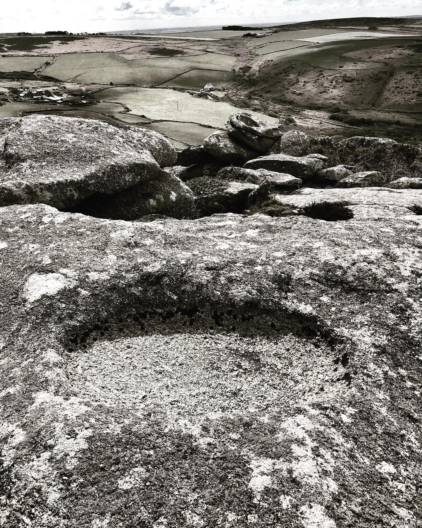 solutions basins . zennor hill. special stones that hold fresh rain water ; the basins slowly wearing through the granite over millennia. undoubtable held in great reverence by our ancestors who saw special significance in there presence on  these hill sites. sometimes accompanied by cup marks believed in turn these basins to be the work of their ancestors marking out their territory.  some of these basins work their way through the whole tor stone as seen herein the middle ground and are found incorporated into early monuments such as the men-an-tol and at carn brea. ..#solutionsbasin #monument #tors #waterbasins #ancestors #archaeology #ancienthistory #prehistory #ancientwisdom.