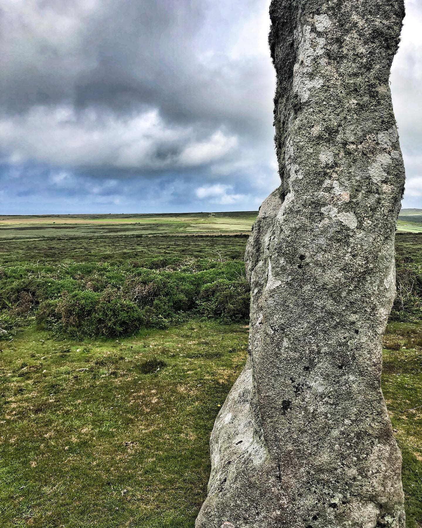 boswens menhir and cairn. at 210m above sea level and 2.38 high this menhir is intervisible with chun quoit and the tregaseal holed stone row and stone circle (just). it was first recorded by dr borlase in 1754 in the midst of a small stone cairn 7.5m in diameter and covering a third of its height...#menhir, #menhirs #boswensmenhir, #carne, #cairn, #chunquoit, #holedstones, #holedstonerow, #westpenwith, #cornwall, #ancientstones, #megalith, #orthostat, #longstone..montagecity.com