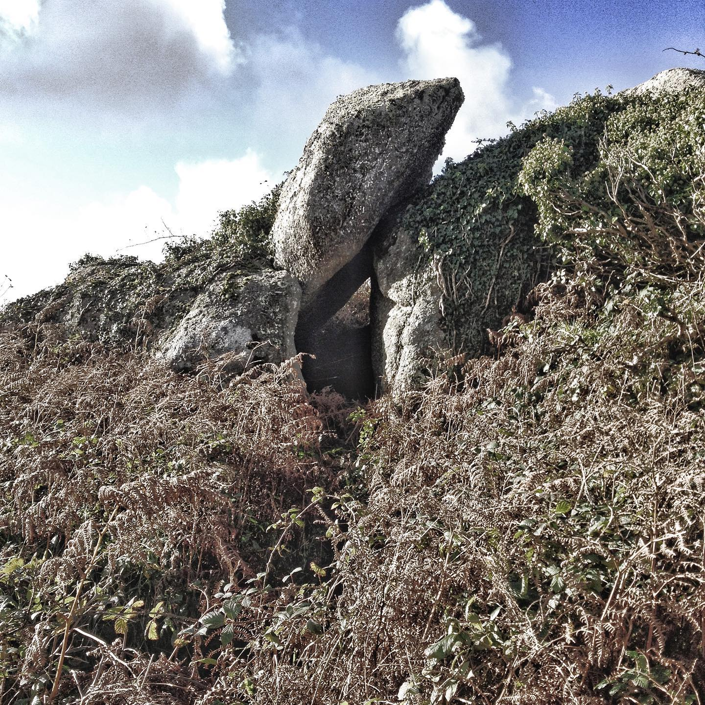 trevalgon hill revisited. west penwith.  the large torstone that forms the right hand side of this chamber like formation has a large rock basin on its upper surface. the upright stone forms the roof to the chamber that is large enough to crouch within it; a natural archetype for the quoits that populate the area perhaps... #trvalgonhill, #westpenwith, #prehistoricarchitecture, #monuments, #cave, #naturalrockformation, #monumentsinthemaking, #ancienthistory, #rockbasin, #solutionsbasin, #rockchamber,#montagecity.com