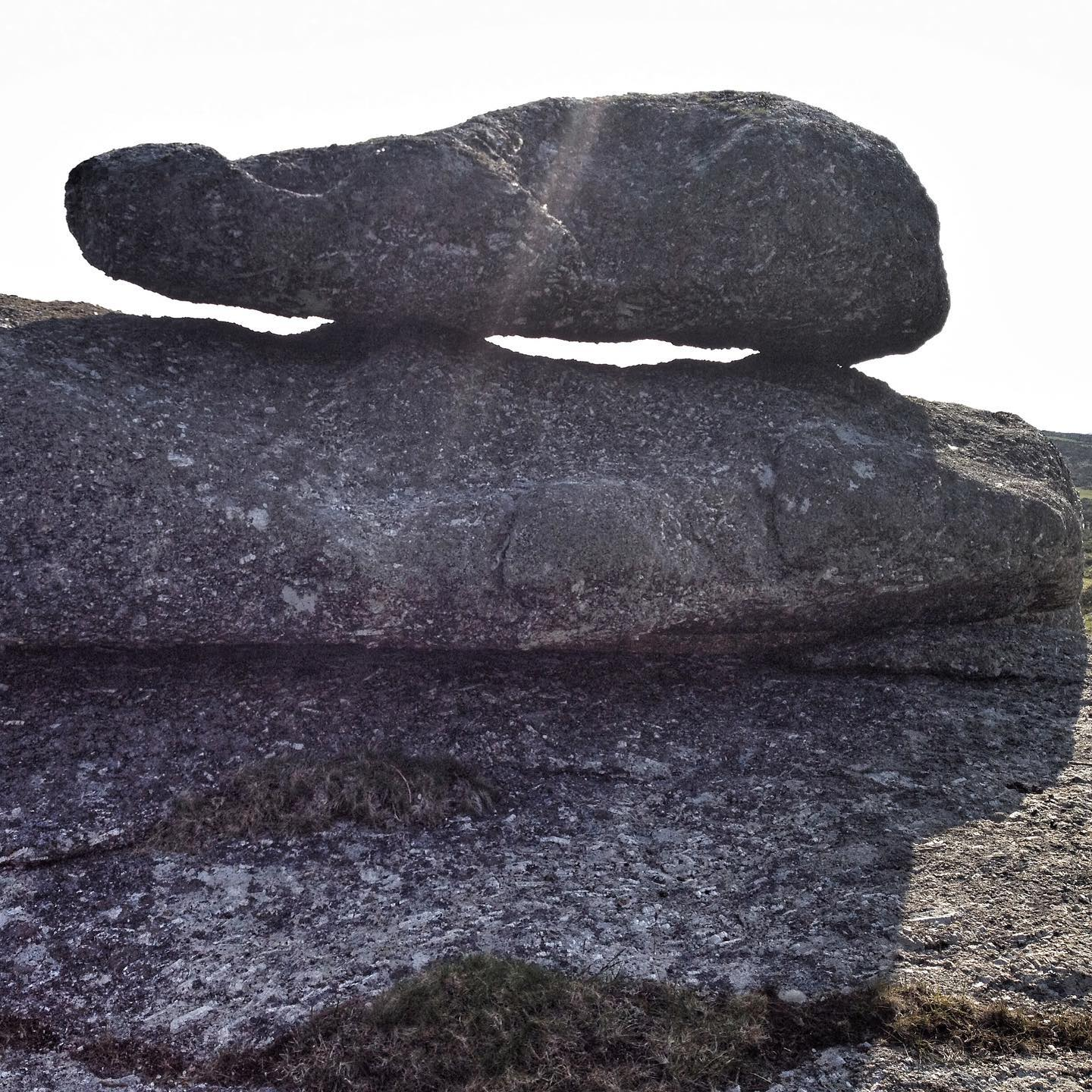 rosewall hill revisited. balancing stone. logan stone. rock basin. 2012-2021. this rather special stone is found adjacent to the main tor outcrop at western end of rosewall. there are three main granite outcrops along the crest of rosewall hill, all with significant features that would have made them candidates for inclusion in the ancient cosmologies of our ancestors. the extraordinary shape of the tors, the balancing stones and the rock basins  might well be understood as the work of the ancestors. the landscape has been much mutilated by more recent mining activity but tin mining here goes back to the bronze age and there are the remains of some built stone monuments, two standing stones and a stone cairn circle. ..#rosewallhill, #loganstones, #balancingstones, #rockbasins, #solutionsbasins, #naturalstonefeatures, #theancestors #ancientcosmolgy, #ancientwisdom, #ancienthistory, #prehistory, #westpenwith, #montagecity.com